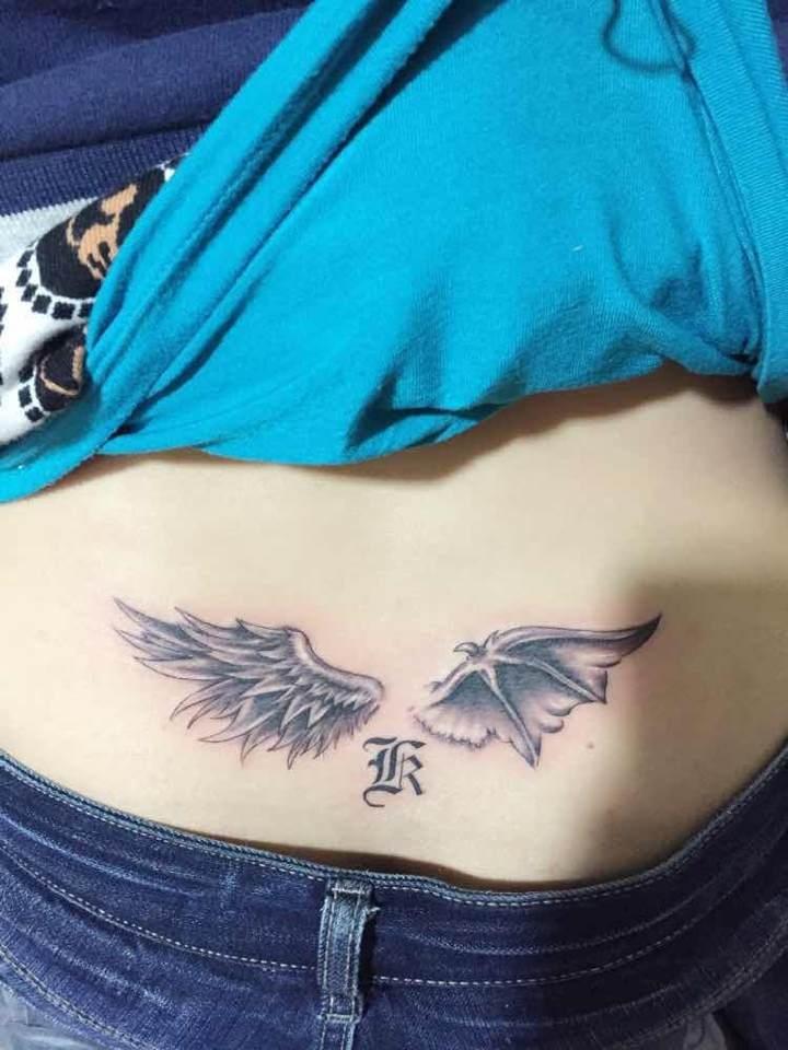 南京小美女腹部天使与魔鬼翅膀纹身图案